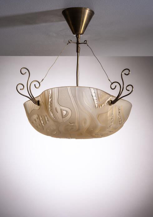 Bloomberry - Orrefors pendant with decorated glass and scrolled brass elements