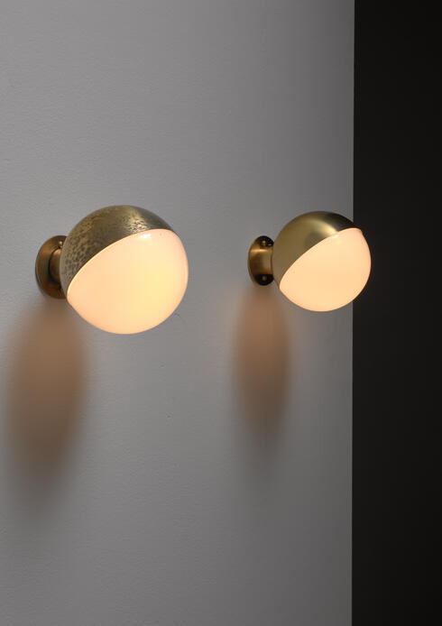 Bloomberry - Vilhelm Lauritzen pair of opaline glass and brass wall lamps