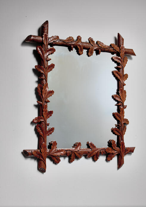 Bloomberry - Early 20th century carved nutwood mirror with leaf decorations, Denmark