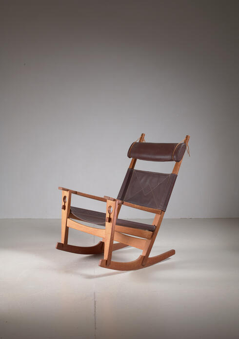 Bloomberry - Hans Wegner key hole rocking chair in original brown leather